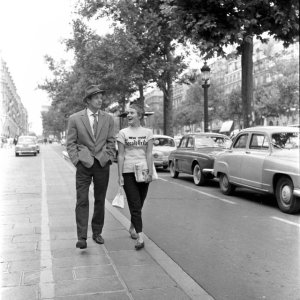 Michel with Patricia, an American selling a NY newspaper on the streets of France
